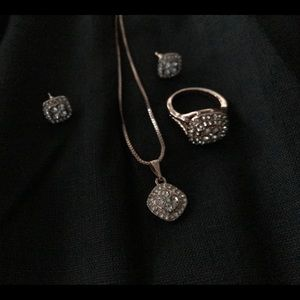 Rose Gold 4 piece cubic zirconia set. Ring size 7